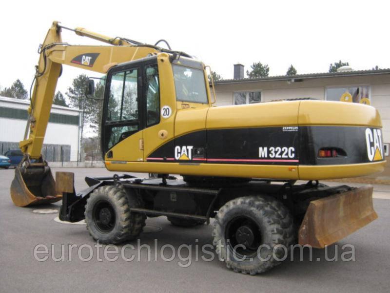 Колесный экскаватор Caterpillar M322С.