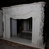 Камин 0312 Портал для камина из белого мрамора с резьбой в французском стиле