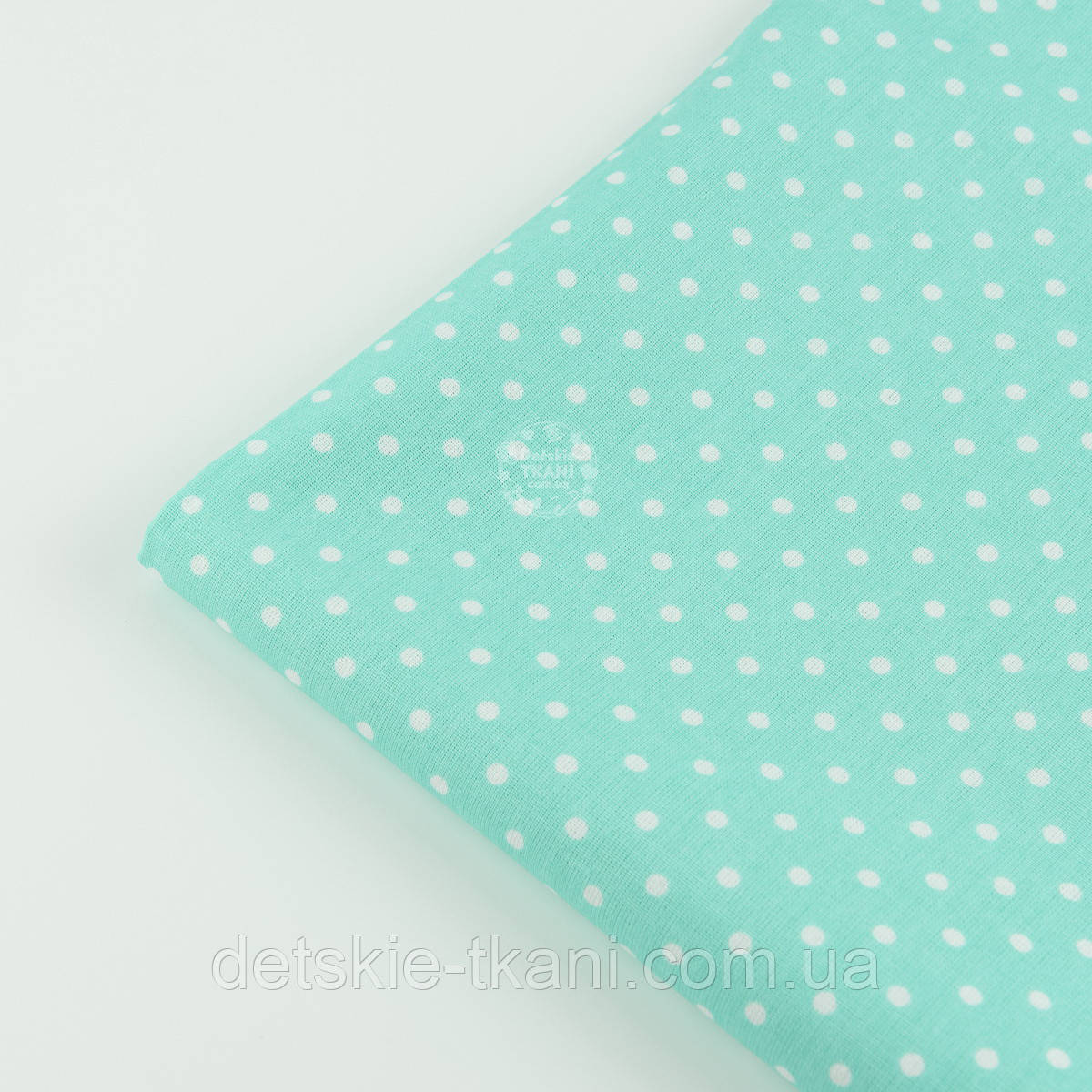 Лоскут ткани №804 с белым горошком 4 мм на мятном фоне