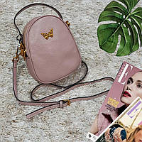Брендовая розовая маленькая сумка из натуральной кожи