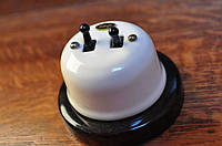 Выключатель рычажковый  двухклавишный проходной  белый, фурнитура черный металл, бронза.