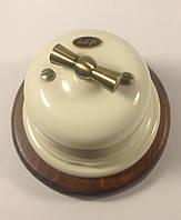 Выключатель 1-клавишный проходной  белый, фурнитура дерево, бронза.