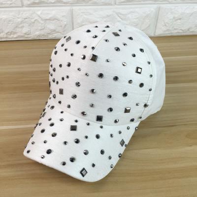 Женская кепка с заклепками и камнями белая