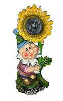 Садовая фигура Гном с подсолнухом голубой колпак 53 см