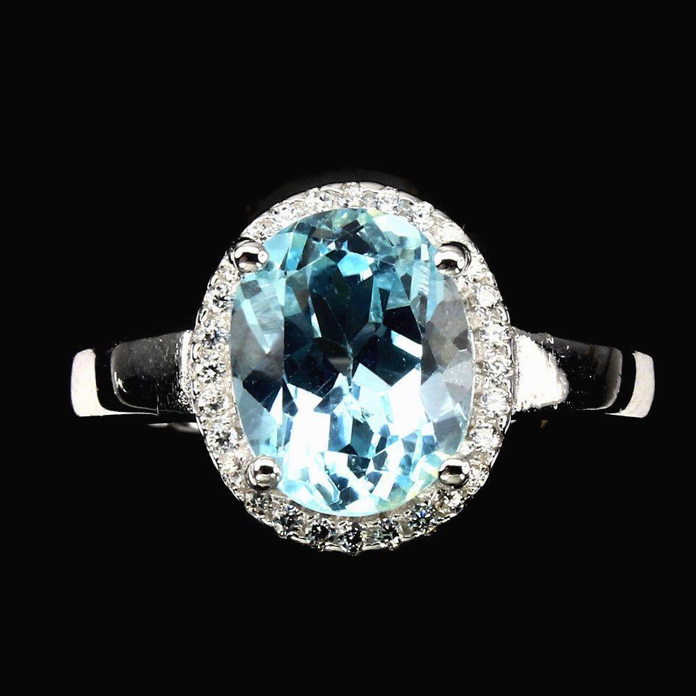 Кольцо с Небесно-голубым Топазом и фианитами