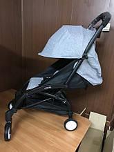 Детская коляска Yoya 175 А+ цвет серый меланж на черной и белой рамах. Увеличенный капор.