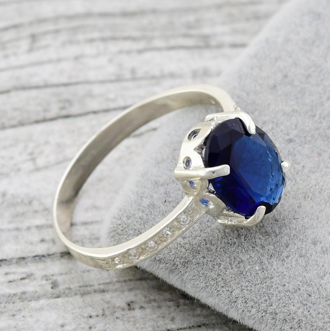 Серебряное кольцо 1153 пк, вставка синий алпанит, вес 2.14 г, размер 18