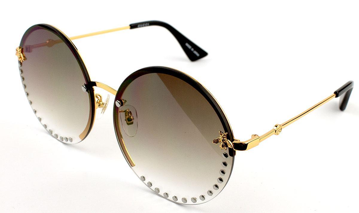 Солнцезащитные очки Gucci GG1072S