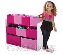 Рожевий органайзер для іграшок, полиця з ящиками.
