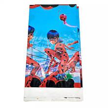 Святкова скатертина одноразова леді баг 110*180 см