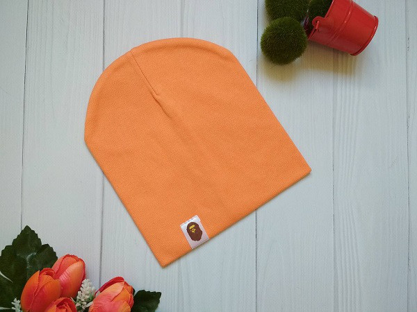 Двухслойная детская шапка оранжевого цвета