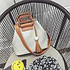 Женская сумка серая с кисточкой и коричневым ремешком из экокожи