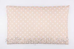 Дитяча подушка 60*40 для новонароджених бежевого кольору з горошком.