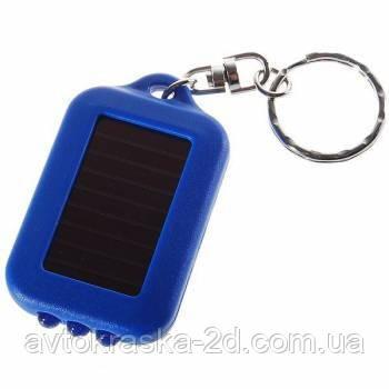 Светодиодный фонарь брелок с зарядкой от солнечных батарей.