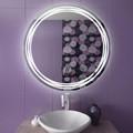 Круглое зеркало в отделке стены