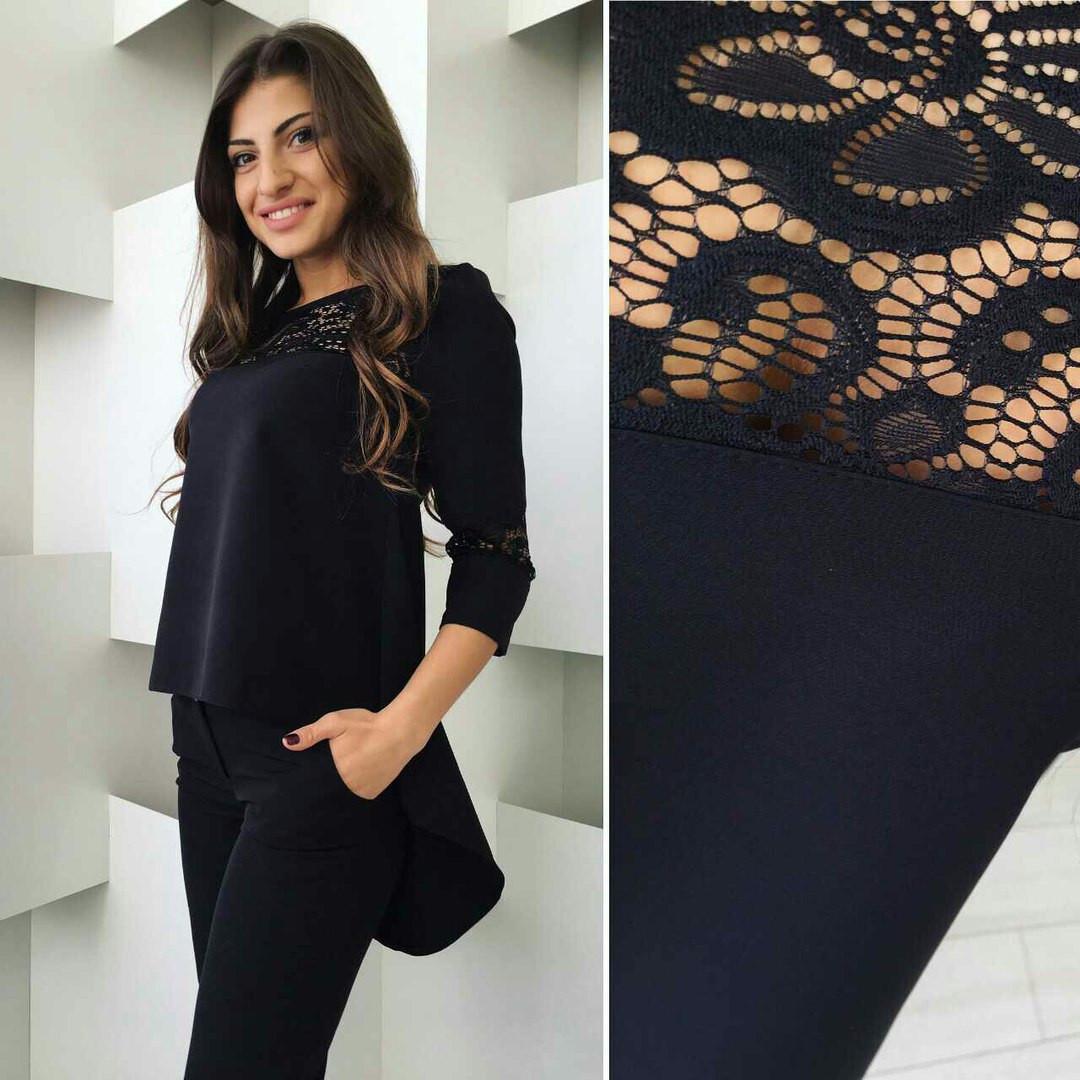 2ebdca66d0a Красивый женский брючный костюм с ассиметричной блузой с гипюром ...