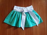 Спідничка для дівчаток м'ятного кольору в дрібний білий горошок