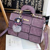 Большая женская сумка Mei&ge с металлическими ручками и брелком лиловая