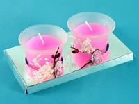 Розовая свеча в стакане