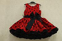 Нарядное платье на девочку в стиле Стиляги  красное в черный горох с черным подьюпником