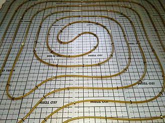 Укладка контура теплого пола методом улитка
