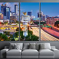 1638 Atlanta, Georgia, USA downtown skyline over Interstate 85.