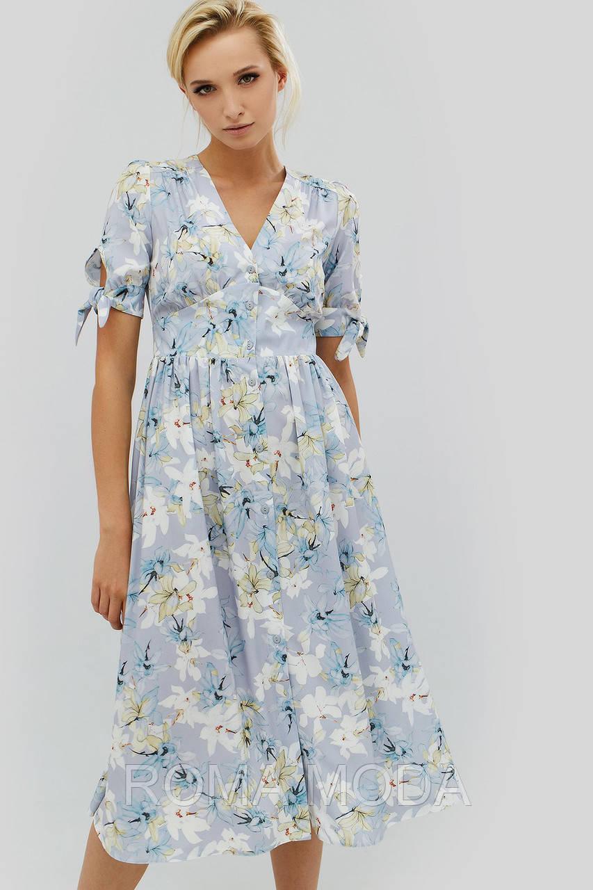 Нежное женское платье с цветочным принтом EDS