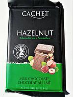 Шоколад молочный с лесным орехом Cachet