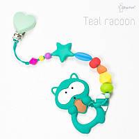 Силиконовая игрушка-грызунок на держателе Teal racoon BABY MILK TEETH