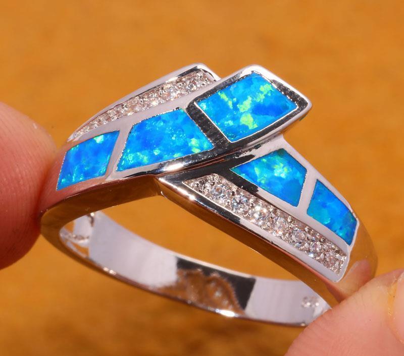 Кольцо с огненным опалом и цирконом в серебре 18,0.