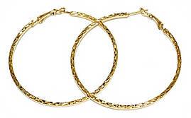 Буланые серьги-кольца с рифлением. Цвет: позолота. Диаметр: 6 см. Ширина: 2 мм.