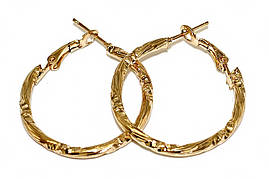 Буланые серьги-кольца с рифлением. Цвет: позолота. Диаметр: 3 см. Ширина: 2 мм.