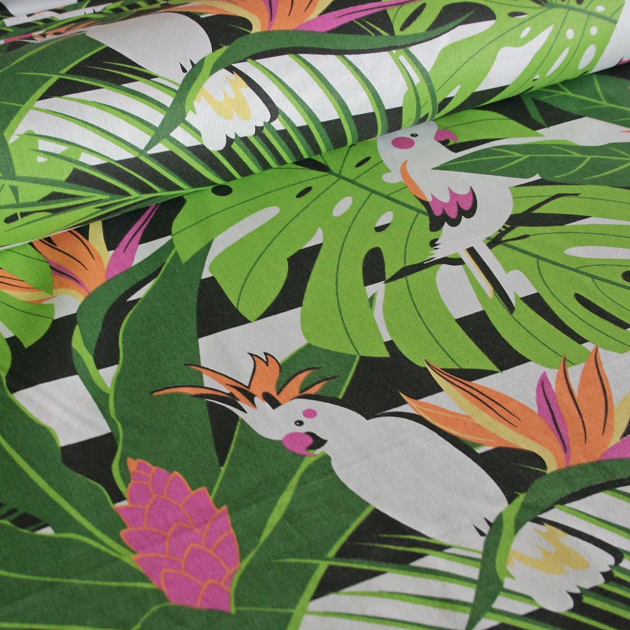 Хлопковая ткань польская попугаи белые в зеленых листьях на черной полоске
