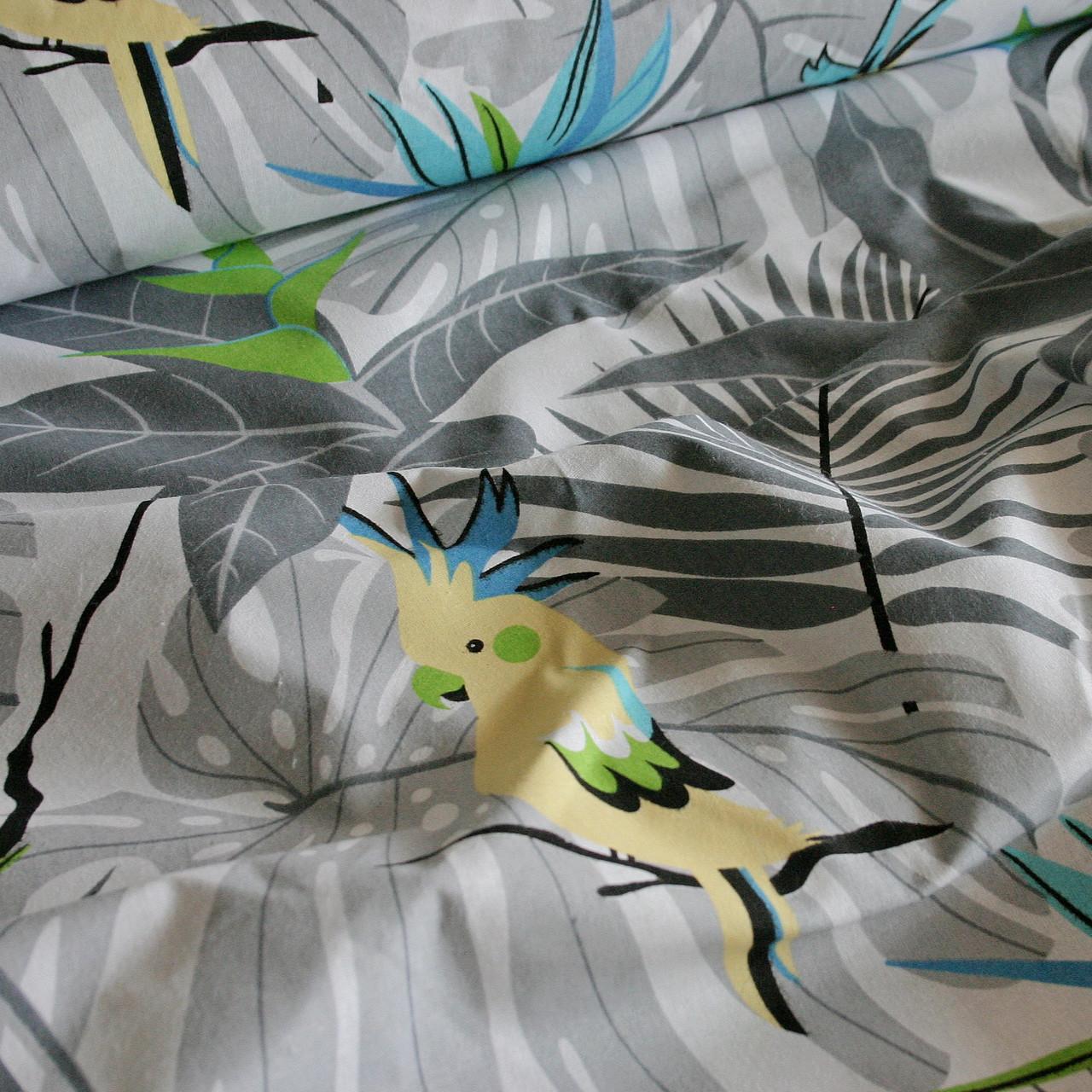 Хлопковая ткань польская попугаи желтые на серых листьях