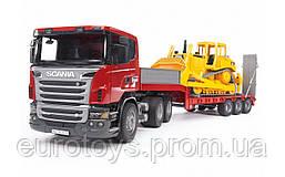 Игрушка Bruder Тягач Scania с грузовой  платформой  и  гусеничным бульдозером CAT 1:16  (03555)