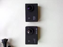 Сравнение двух камер. Расположение элементов абсолютно одинаковое.  SJ4000 имеет надпись HD1080P а SJ4000 c WiFi обязатьльно надпись SJCAM под линзой и слово wifi над SJ4000.