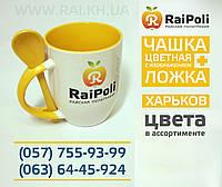 Чашка з ложкою жовта всередині з зображенням