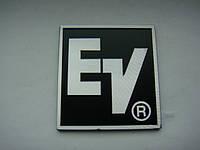 Шильдик EV (Electro voice) 50x48mm на сетку колонки, фото 1