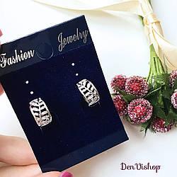 """Сережки """"Flower""""двосторонні, вкриті білим золотом."""