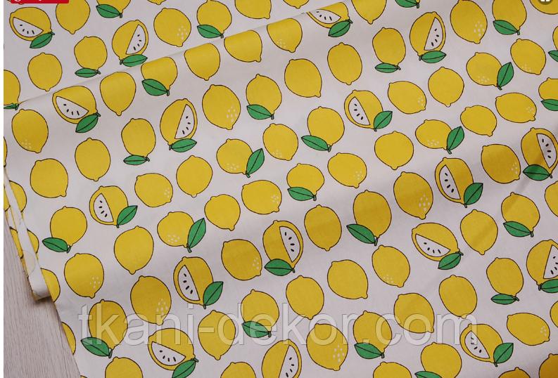 Сатин (хлопковая ткань) на белом фоне лимоны