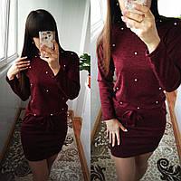 Женское платье с бусинами