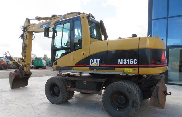Колёсный экскаватор Caterpillar M316C 2003 года, фото 1