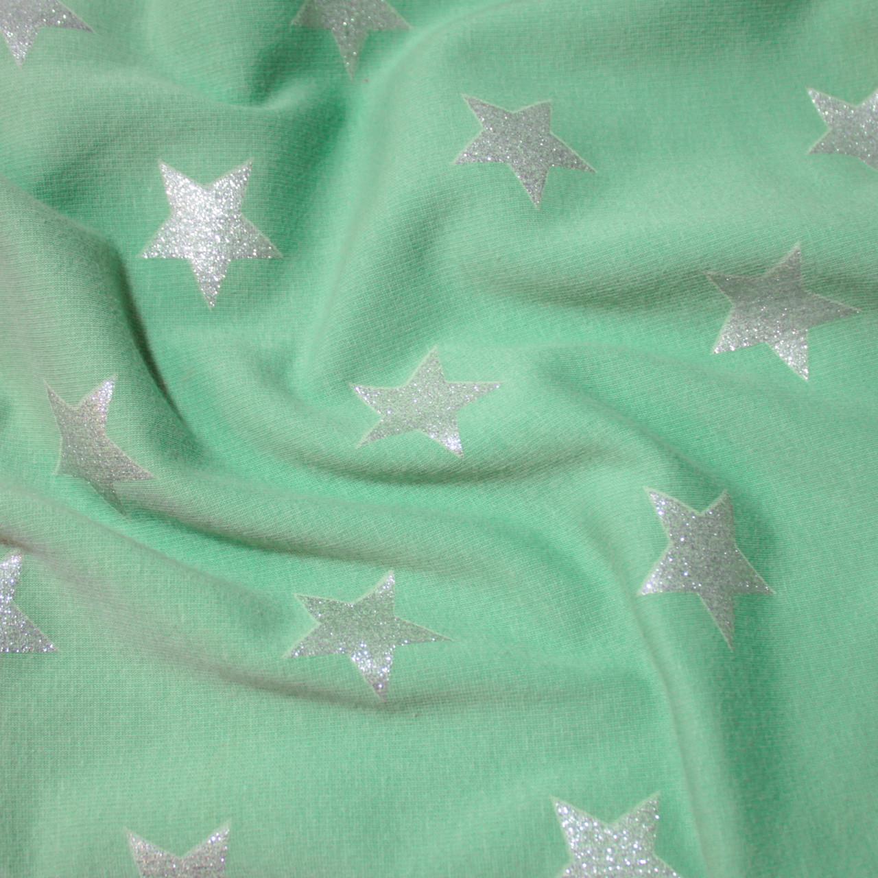 Трикотаж на меху принт звезды на светло-зеленом
