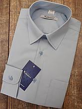 Блакитна шкільна сорочка