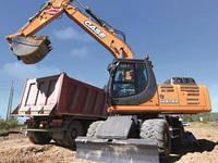 Пневмоколёсный экскаватор O&K массой 8,5 тонн