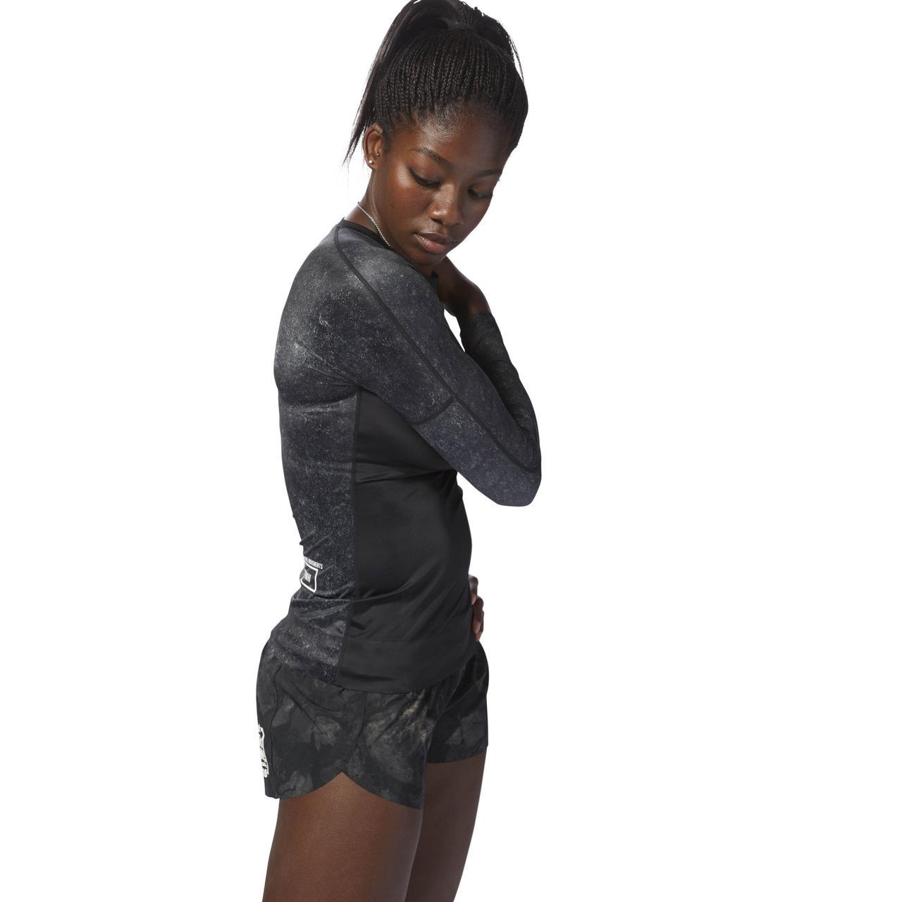 Купить Женская футболка Reebok Crossfit Paddle (Артикул  D94953) в ... 4ffda9a042055