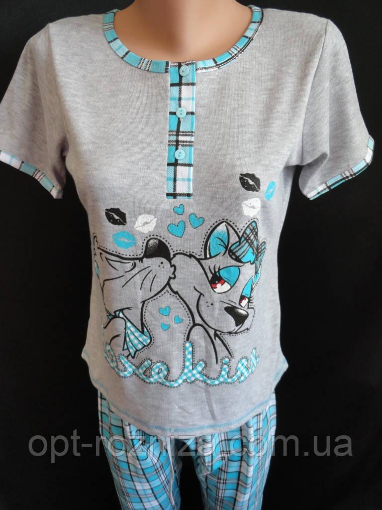 Трикотажные пижамы с бриджами в клетку.