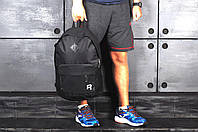 Рюкзак в стиле Reebok, черный с белым логотипом, материал - полиестер, дно - кожаное. Код товара AA-R0061