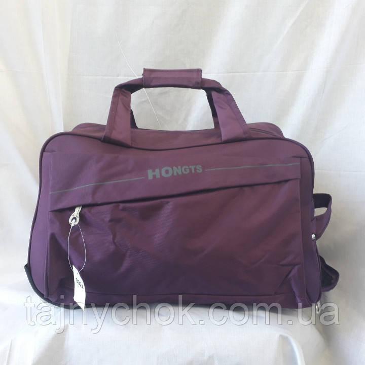 Фиолетовая сумка на колесах 60 см