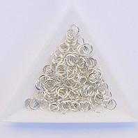 Соединительные колечки диаметр 6 мм толщина 0,7 мм св. серебро (примерно 0,5 кг)
